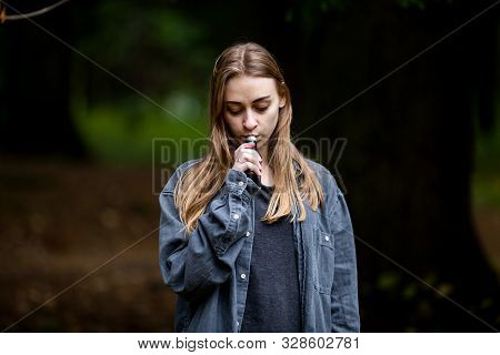 Vape Teenager. Young Beautiful White Teenage Girl In Casual Clothes Vaping Electronic Cigarette On T