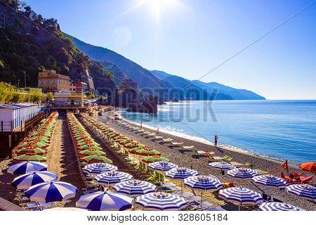 Panorama Of Monterosso Al Mare Beach, In Summer Season, A Coastal Village And Resort In Cinque Terre