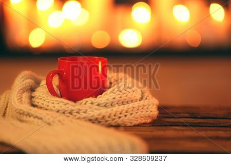 Cup Of Hot Drink On Wooden Table Against Blurred Background, Space For Text. Winter Atmosphere