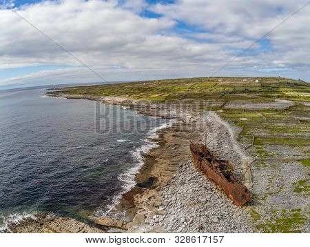 Aerial View Of Lighthouse And Wrecked Boat  In Inisheer Island