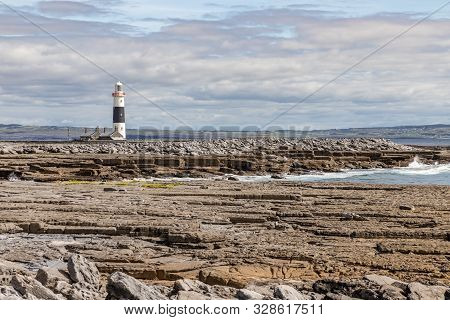 Lighthouse  And Rocky Beach In Inisheer Island
