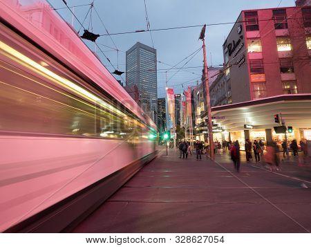 Australia, Melbourne - September 2, 2016: Long Exposure Of Melbourne City Tram And People Walking Ar