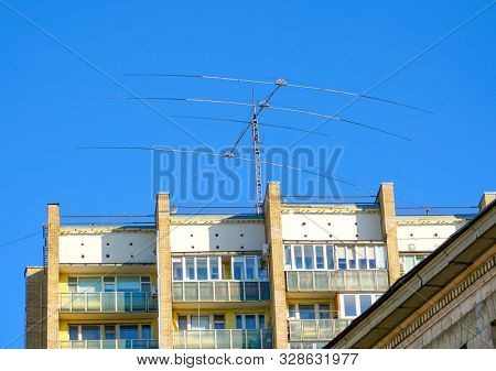 Moscow - August 2019: Short wave directional antenna for amateur radio communications on the roof of a residential building.