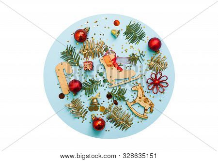Chirstmas Decorations On Blue And White Background. Flat Lay, Top View. Wood Toys, Red Balls, Pine T