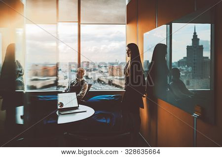 Business Meeting In A Board Room On The Top Floor Of A Modern Luxury Office Skyscraper, Silhouettes