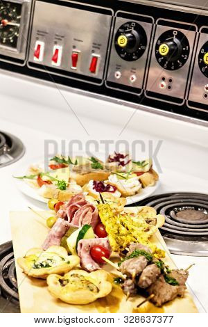 Beautifully garnished snacks in plates poster