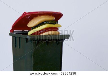 Waste Food Put Into A Rubbish Bin.
