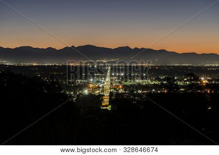 Predawn view of Devonshire Street in the North San Fernando Valley area of Los Angeles, California.  The San Gabriel Mountains are in background.