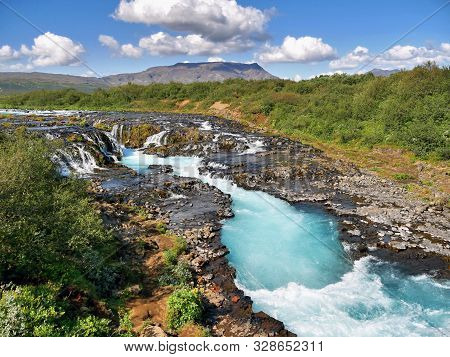 Blue River Waterfall And Cascade. Iceland Beautiful Landscape