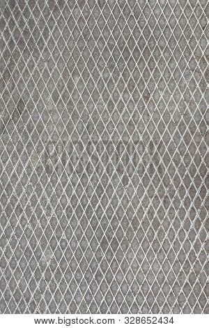 Metallic Texture Belonging To Some Street Furniture. Worn Metal Texture With Detail. Metal Stamping