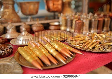 Close-up On Bullet Pens In Kazandziluk Street, The Famous Coppersmith Trading Place Located In Basca