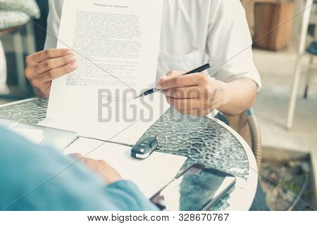 Agent Shows Car Insurance To Lender. Salesman Dealer Presenting Purchase Order Contract To Customer.
