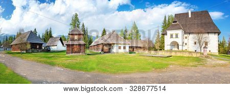 Old Traditional Houses And Belfry Of Village Pribylina In Liptov Region (slovakia) - Panorama