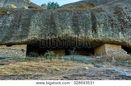 Caves of hermits in Meteora near Kastraki village, Greece