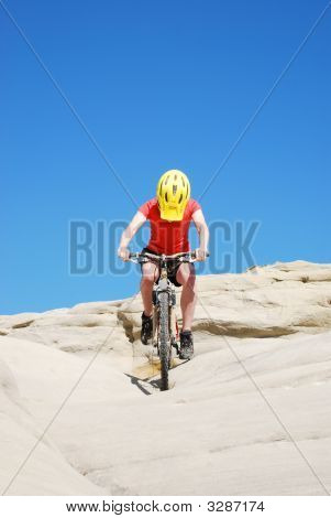 Mountain Biker Against Blue Sky