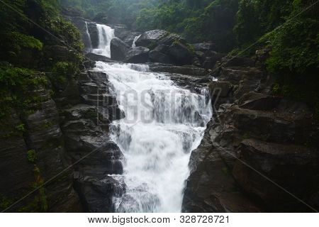 Close Up Of Waterfall In Shillong In Motion Blurr  And Rocks, Selective Focusing