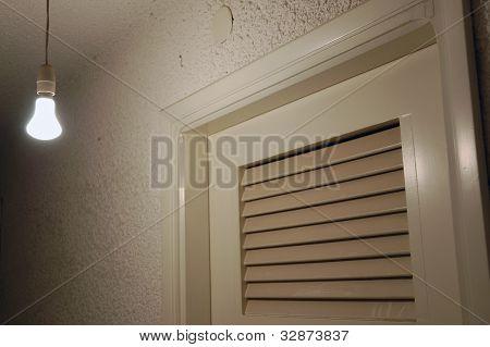 Light Bulb And Door In Dark Basement