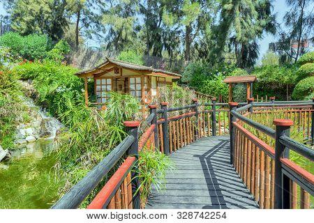 Bridge In A Japanese Garden. Colorful Landscape.