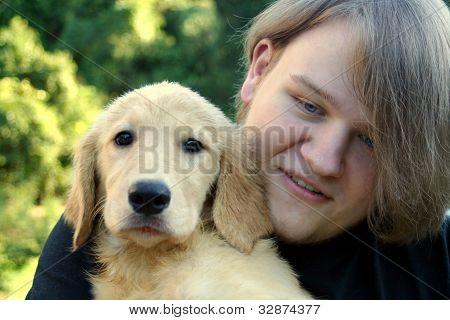 Teen Boy And Golden Puppy 2