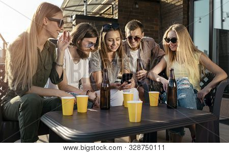Cheerful Youngsters Posting Photos Of Their Party In Social Media