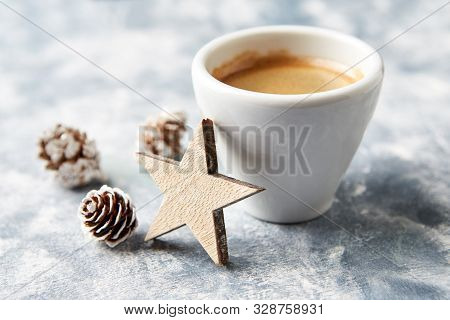 Wooden Christmas Star And A Cup Of Coffee On Bright Wooden Background. Close Up.