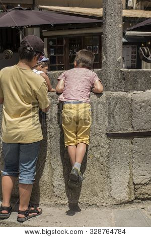 Carcassonne Languedoc-roussillon France - June 25, 2019: Children And Other Tourists Looking Down An