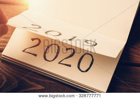 Notepad Or Calendar With Pages And Text 2020 And 2019 In Sunlight. New Year, New Beginnings And Chan