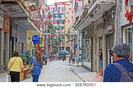Athens, Attica, Greece - October 17, 2018:  Tourists Walking And Shopping Along An Athens, Greece Ci