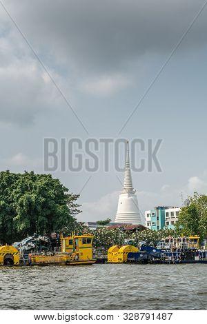 Bangkok City, Thailand - March 17, 2019: Chao Phraya River. Wat Prayurawongsawat White Spire Of Budd