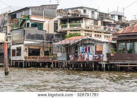 Bangkok City, Thailand - March 17, 2019: Chao Phraya River. Laundry At Poor Dwelling Built On Stilts