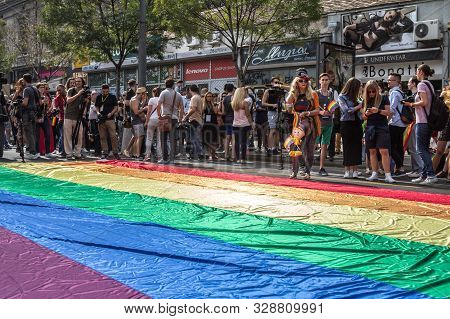 Belgrade, Serbia - September 18, 2016:  Crowd Of Protestors Standing Behind A Giant Rainbow Gay Flag