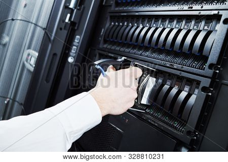 Cloud storage service. engineer replacing hard drive disk hdd in server