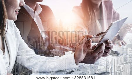 Double Exposure Image Of Business People Group Meeting On City Office Building In Background Showing