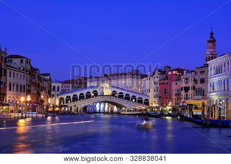 Venice, Italy - October 11, 2019: View Of The Rialto Bridge And Grand Canal In A Blue Hour At Sunset