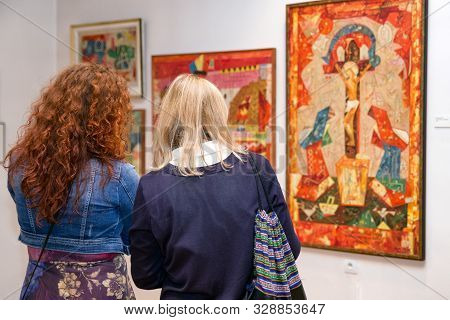 Ruzomberok, Slovakia - September 19: Visitors Looking At Ludovit Fulla Painting In His Gallery On Se