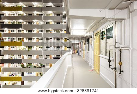 Singapore-1 May 2018:residential Building Facade Window And Corridor In Night