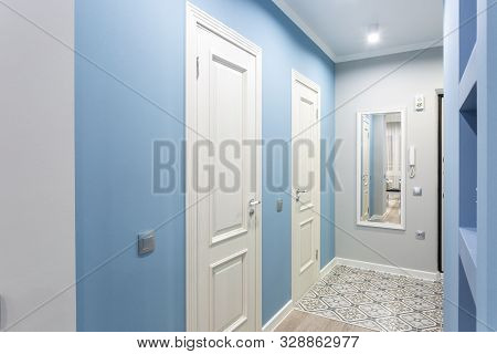 Minsk, Belarus - September, 2019: Door In Modern Entrance Hall Of Corridor In Blue Light Color In Ex