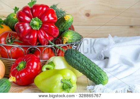 Colorful Background With Vegetables Harvest In Wicker Basket On Wooden Background Covered With White