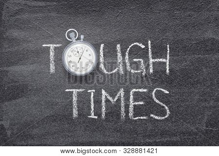 Tough Times Phrase Written On Chalkboard With Vintage Precise Stopwatch