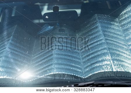 Front Screen Of A Car With Sun Protection