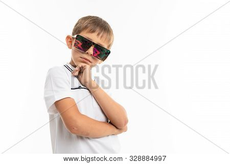 A Little Boy In A White Shirt, Blue Shorts With Blonde Hair, White T-shirt Shows That He Is Cool.