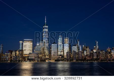 New York City, United States - September 18, 2019: Lower Manhattan Skyline At Night. View From Jerse