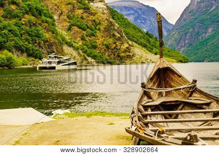 Old Viking Boat And Ferryboat On Fjord, Norway