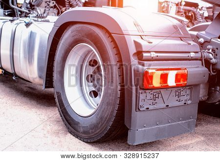 The Back Of A Modern European Cargo Delivery Truck. Logistics And Freight Concept, Background, Wheel