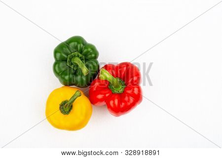 Top View Pepper Sweet Green Red And Yellow On The White Isolated Background