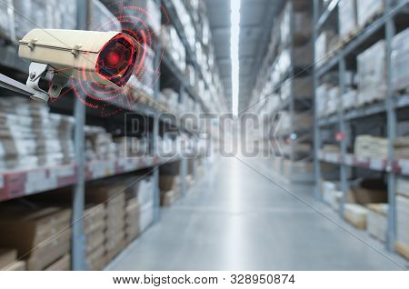 Cctv. Security Camera Motion Detect System Operating In Warehouse Interior With Product On Shelves I