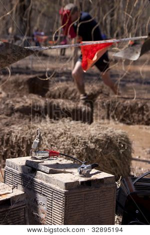 POCONO MANOR, PA - APR 29: The battery that sends electricity to wires in an obstacle at Tough Mudder on April 29, 2012 in Pocono Manor, Pennsylvania. The course is designed by British Royal troops.