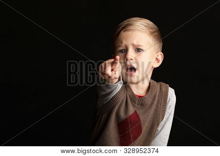Little Blond Boy 3-4 Years Old Stretching His Finger In The Air Because He Something Want. Backgroun