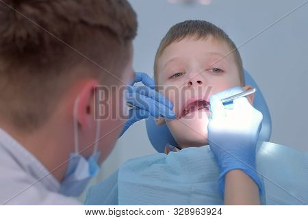 Dentist Chekup Child Boy Teeth With Dental Mirror And Hook On Preventive Examination In Dentistry Cl