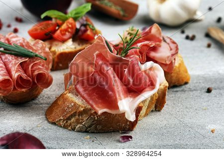 Assorted Bruschetta With Various Toppings. Appetizing Bruschetta Or Crudo Crostini. Variety Of Small